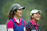 Liu Yu of China (left) chats with Lin Tzu-Chi of Chinese Taipei (right) at the 6th hole during Round 4 of the World Ladies Championship 2016 on 13 March 2016 at Mission Hills Olazabal Golf Course in Dongguan, China. Photo by Victor Fraile / Power Sport Images