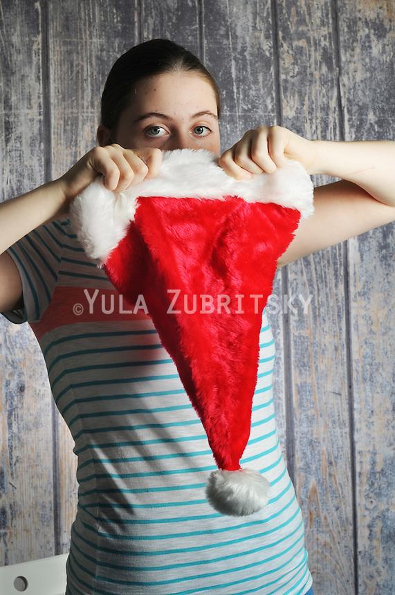 Girl wearing Santa hat Christmas