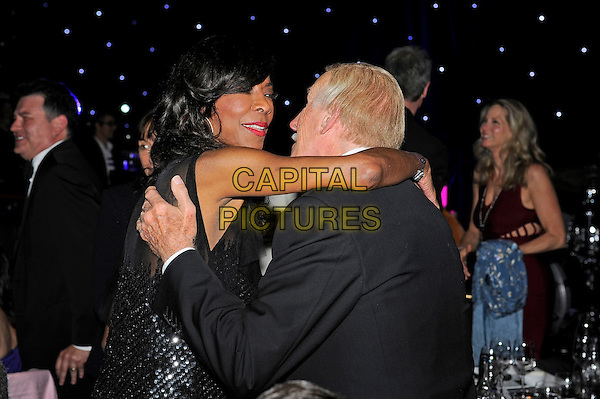 LONDON, ENGLAND - May 13: Natalie Cole and Bruce Forsyth embrace at the UK Premiere of 'Nat King Cole. Afraid of The Dark' at The May Fair Hotel on May 13, 2014 in London, England.<br /> CAP/MAR<br /> &copy; Martin Harris/Capital Pictures