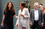 US Robert De Niro and Grace Hightower with Roberta Armani leave the Giorgio Armani's Fashion Show as part of the Milan's Fashion Week Men's wear Spring/Summer 2016, in Milan on June 23, 2015.