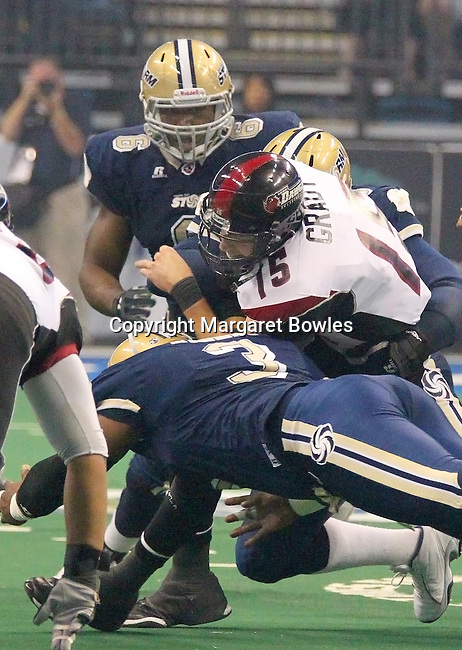 05 June 2010: The Tampa Bay defense swarms and sacks Oklahoma City quarterback Tommy Grady. The Tampa Bay Storm defeated the Oklahoma City Yard Dawgz 50-48 at the St. Pete Forum in Tampa, Florida