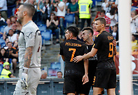 Roma s Edin Dzeko, right, celebrates with his teammates Stephan El Shaarawy, second from right, and Lorenzo Pellegrini, after scoring during the Italian Serie A football match between Roma and Chievo Verona at Rome's Olympic stadium, 28 April 2018.<br /> UPDATE IMAGES PRESS/Riccardo De Luca