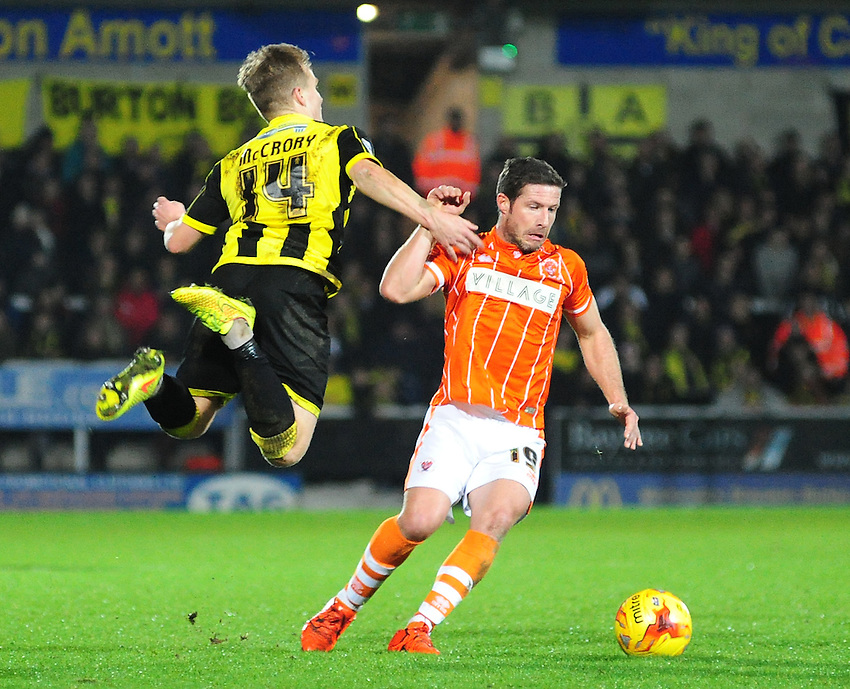 Blackpool&rsquo;s David Norris vies for possession with Burton Albion's Damien McCrory<br /> <br /> Photographer Chris Vaughan/CameraSport<br /> <br /> Football - The Football League Sky Bet League One - Burton Albion v Blackpool - Saturday 2nd January 2016 - Pirelli Stadium - Burton   <br /> <br /> &copy; CameraSport - 43 Linden Ave. Countesthorpe. Leicester. England. LE8 5PG - Tel: +44 (0) 116 277 4147 - admin@camerasport.com - www.camerasport.com