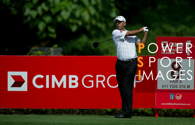 Jeev Milkha Singh tees off at the eighth during Round 2 of the CIMB Asia Pacific Classic 2011.  Photo © Raf Sanchez / PSI for Carbon Worldwide