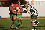 Ra Garmonsway is all determination as he bursts past Matt Talaese. Counties Manukau Premier Club Rugby game between Wauku & Manurewa played at Waiuku on Saturday June 6th. Manurewa won 36 - 31 after leading 14 - 12 at halftime.