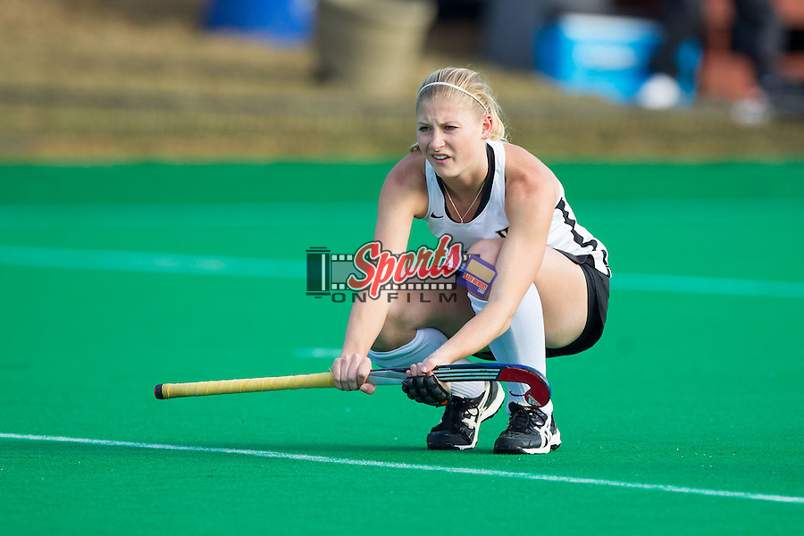 Jess Newak (3) of the Wake Forest Demon Deacons waits to receive the ball during a penalty corner against the Old Dominion Monarchs during Round One of the 2013 NCAA Field Hockey Championship at Francis E. Henry Stadium on November 16, 2013 in Chapel Hill, North Carolina.  The Demon Deacons defeated the Monarchs 3-2.  (Brian Westerholt/Sports On Film)