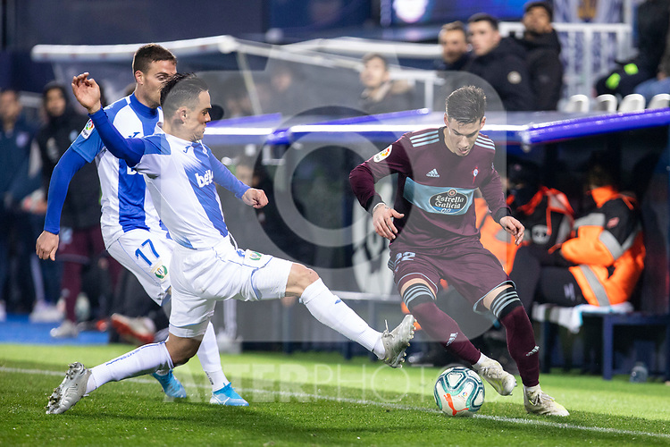 CD Leganes's  Roque Mesa and Javier Eraso (L) and RC Celta de Vigo's Santi Mina during La Liga match 2019/2020 round 16<br /> December 8, 2019.  <br /> (ALTERPHOTOS/David Jar)
