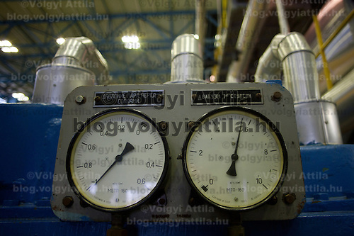 Analouge gauges are seen in the turbine hall of the Paks nuclear power plant building in Paks, 120 km (75 miles) east of Budapest, Hungary on March 23, 2011. ATTILA VOLGYI
