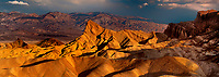 915000006 panoramic view of sunrise over the colored sandstone formations of manly beacon and zabriski point in death valley national park california