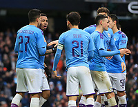 26th January 2020; Etihad Stadium, Manchester, Lancashire, England; English FA Cup Football, Manchester City versus Fulham; Gabriel Jesus of Manchester City is congratulated by his team mates after scoring his side's fourth goal