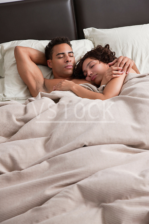 USA, New York City, couple asleep in bed