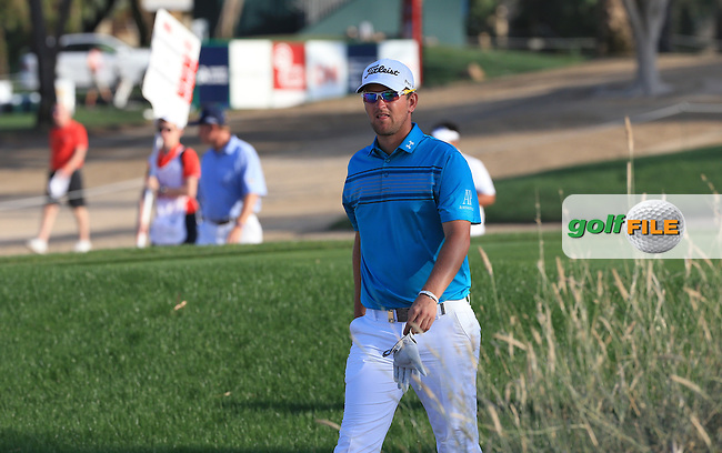 Bernd Wiesberger (AUT) heading down the 18th during Round One of the 2016 Omega Dubai Desert Classic, played on the Emirates Golf Club, Dubai, United Arab Emirates.  04/02/2016. Picture: Golffile | David Lloyd<br /> <br /> All photos usage must carry mandatory copyright credit (&copy; Golffile | David Lloyd)