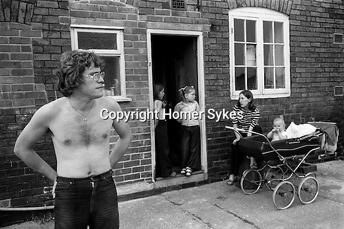 Miner, Clive Blackhouse and family. Carol Blackhouse with new baby Craig. Two children in the back doorway are Tracy and Kathleen Whitehall. Northfield estate, South Kirkby. South Kirkby colliery Yorkshire England. 1979.