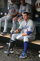 SAN FRANCISCO - SEPTEMBER 13:  Jim Thome of the Los Angeles Dodgers gets ready to bat in the dugout during the game against the San Francisco Giants at AT&T Park on September 13, 2009 in San Francisco, California. Photo by Brad Mangin