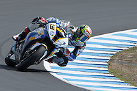 Chaz Davies (GBR) riding the BMW S1000 RR HP4 (19) of the BMW Motorrad GoldBet SBK Team rounds turn 6 during a qualifying session on day one of round one of the 2013 FIM World Superbike Championship at Phillip Island, Australia.