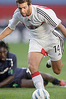 D.C. United's Ben Olsen gets past the tackle of the New England Revolution's Shalrie Joseph. The New England Revolution and D.C. United finished in a scoreless tie in MLS play at Gillette Stadium, Foxboro, MA on Saturday August 28, 2004.