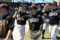 Edgewood Eagles Pat Manning (4) celebrates with teammates after the second game of a doubleheader against the Plymouth State Panthers on March 17, 2015 at Terry Park in Fort Myers, Florida.  Edgewood defeated Plymouth State 9-2.  (Mike Janes/Four Seam Images)