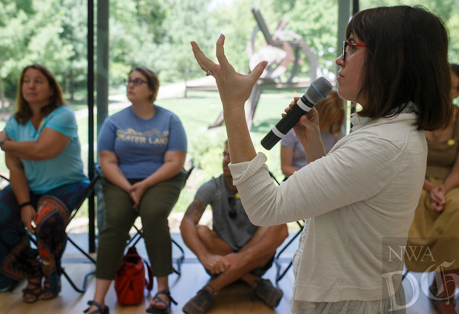 NWA Democrat-Gazette/CHARLIE KAIJO Museum educator Amanda Driver (right) prompts attendees to reflect on a sculpture as part of a meditative exercise during an art meditation event, Monday, August 6, 2018 at Crystal Bridges in Bentonville. <br />