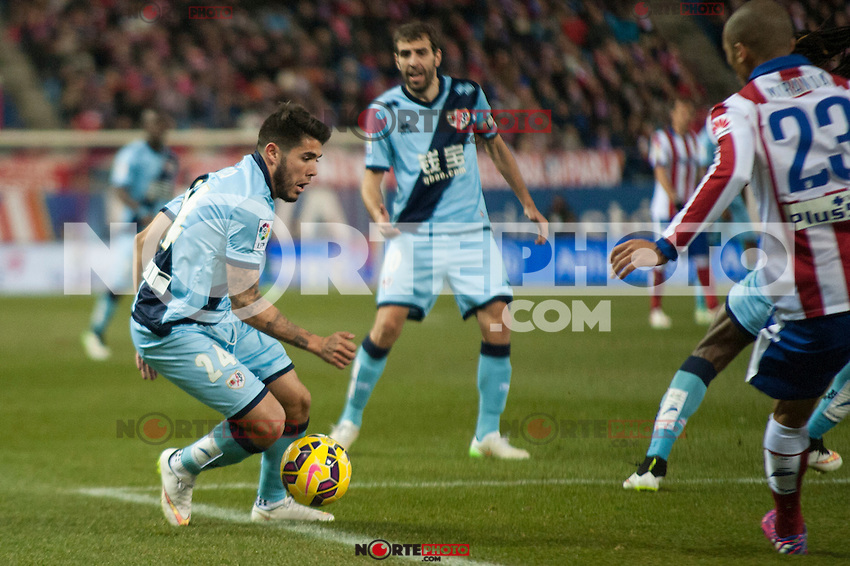 Atletico de Madrid&acute;s Joao Miranda and Rayo Vallecano&acute;s Alejandro Pozuelo during 2014-15 La Liga match between Atletico de Madrid and Rayo Vallecano at Vicente Calderon stadium in Madrid, Spain. January 24, 2015. (ALTERPHOTOS/Luis Fernandez) /NortePhoto<br />