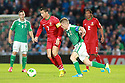 Portugal's Christiano Ronaldo taclkes Northern Ireland's Steven Davis during a World Cup Qualifier in Belfast, Friday September 6th, 2013.  Photo/Paul McErlane