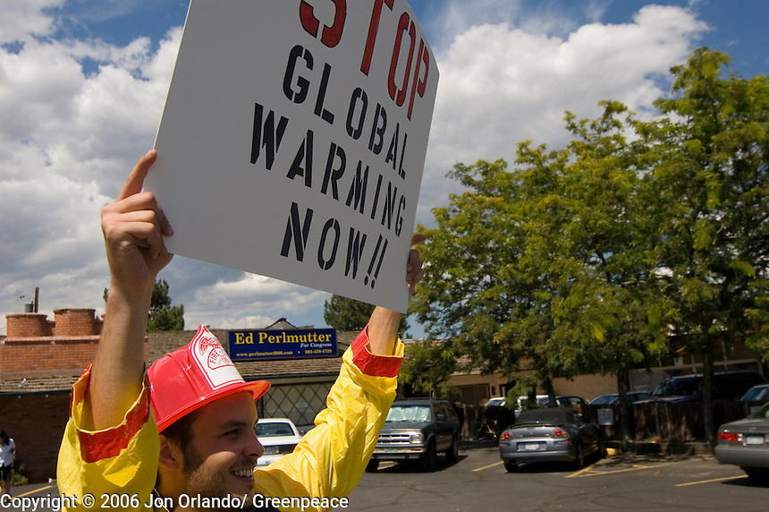 Greenpeace activist, Nathan Rose,  at a rally to raise awareness of the threats of global warming, outside the headquarters of Ed Perlmutter, a Democratic congressional  candidate for district 7 in Colorado.