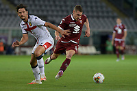 16th July 2020; Olympic Grande Torino Stadium, Turin, Piedmont, Italy; Serie A Football, Torino versus Genoa; Andrea Belotti of Torino FC eludes the challenge from Edoardo Goldaniga of Genoa FC and goes in to score the goal for 3-0 for Torino in the 90th minute