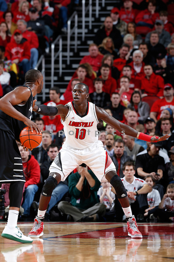 LOUISVILLE, KY - JANUARY 2: Gorgui Dieng #10 of the Louisville Cardinals defends against the Providence Friars during the game at KFC Yum! Center on January 2, 2013 in Louisville, Kentucky. Louisville won 80-62. Gorgui Dieng