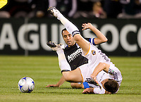 18 April 2009: Dema Kovalenko of the Galaxy trips over Ramiro Corrales of the Earthquakes after Corrales tried to tackle the ball during the game at Oakland-Alameda County Coliseum in Oakland, California.   Earthquakes and Galaxy are tied 1-1.