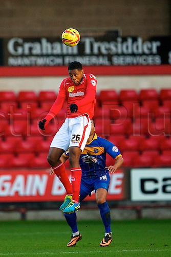 21.12.2013 Crewe, England. Crewe Alexandra midfielder Chuks Aneke with a commanding header during the League One game between Crewe Alexandra and Shrewsbury Town from the Alexandra Stadium.