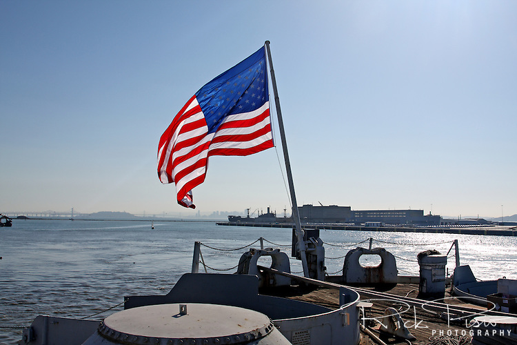 The flag of the United States flies on the fantail of the U.S. Navy battleship U.S.S. Iowa while berthed in Richmond, California prior to its journey to San Pedro, California.