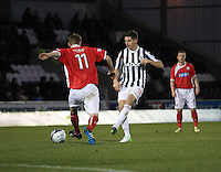 Kenny McLean plays the ball past Gary Fusco in the St Mirren v Brechin City William Hill Scottish Cup Round 4 match played at St Mirren Park, Paisley on 1.12.12.