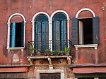 Two doors and two windows, along Fondamenta dei Vetrai on the main canal of Murano, Italy