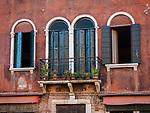 Two doors and two windows, along Fondamenta dei Vetrai on the main canal of Murano, Italy