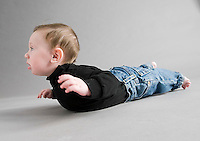 Studio portrait of Caucasian boy laying down