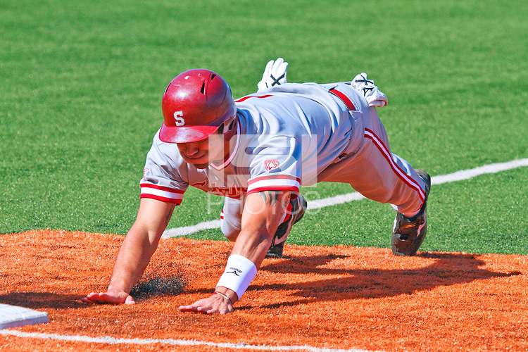 AUSTIN, TEXAS-March 5, 2011:  Tyler Gaffney of Stanford dives back to first base on a pickoff play during the game against the Texas Longhorns, at Disch-Falk field in Austin, Texas.  Stanford defeated Texas 9-2.