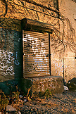 USA, Brooklyn, a loading dock door covered in graffiti at sunset, Williamsburg
