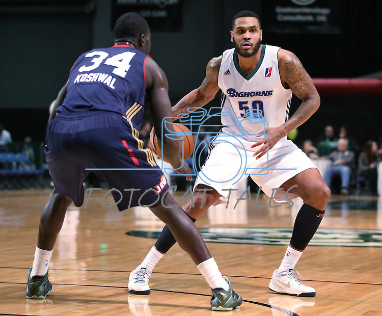 Reno Bighorns' Tyrell Biggs and Bakersfield Jam's Mac Koshwal compete in a D-League basketball game in Reno, Nev., on Tuesday, Jan. 14, 2014. The Bighorns won 93-85.<br /> Photo by Cathleen Allison
