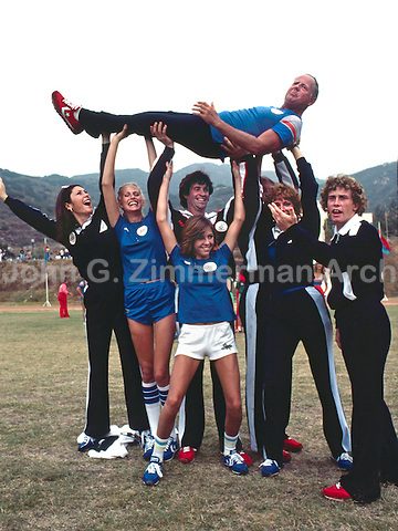 Team ABC at the Battle of the Network Stars, Pepperdine University, Pepperdine CA, November 1979. ABC Team Captain Dick Van Patten is held aloft by teammates (L to R) Diana Canova, Shelley Smith, Robert Hays, Joanna Cassidy and Willie Aames with Kristy McNichol in front) . Photo by John G. Zimmerman.