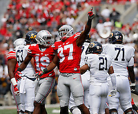Ohio State Buckeyes cornerback Gareon Conley (19) and Ohio State Buckeyes linebacker Joshua Perry (37) celebrate a fumble that was later ruled down by contact during Saturday's NCAA Division I football game against the Kent State Golden Flashes at Ohio Stadium in Columbus on September 13, 2014. Ohio State won the game 66-0. (Dispatch Photo by Barbara J. Perenic)
