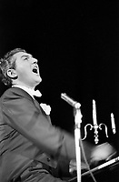 Liberace sings and plays piano during concert, Milwaukee, 1953. Photographer John G. Zimmerman