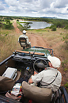 Phinda specialist ranger Daryl Dell and tracker Bernard Mnguni viewing Phinda game reserve, Kwazulu Natal, South Africa