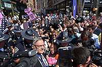 Cleveland, OH - July 19, 2016: Maricopa County Arizona Sheriff Joe Arpaio (bottom, left), escorted by Indiana State Troopers, is surrounded by members of the media and protestors as he walks to a checkpoint to enter the Quicken Loans Arena for the Republican National Convention in Cleveland, Ohio, July 19, 2016.  (Photo by Don Baxter/Media Images International)
