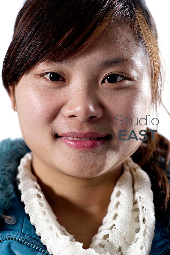 Worker Li Guizhen poses for a photograph in Artissmo Designs factory in Yiwu, Zhejiang province, China, on February 14, 2012. Photo by Lucas Schifres/Pictobank