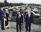 United States Secretary of Defense Dick Cheney hosted an Armed Forces Honor Cordon to welcome Youssuf bin Alawi, Minister of Defense of Oman at the Pentagon in Washington, DC on October 6, 1989.  Secretary Cheney, right, is shown entering the building with Minister Alawi.<br /> Credit: Department of Defense via CNP