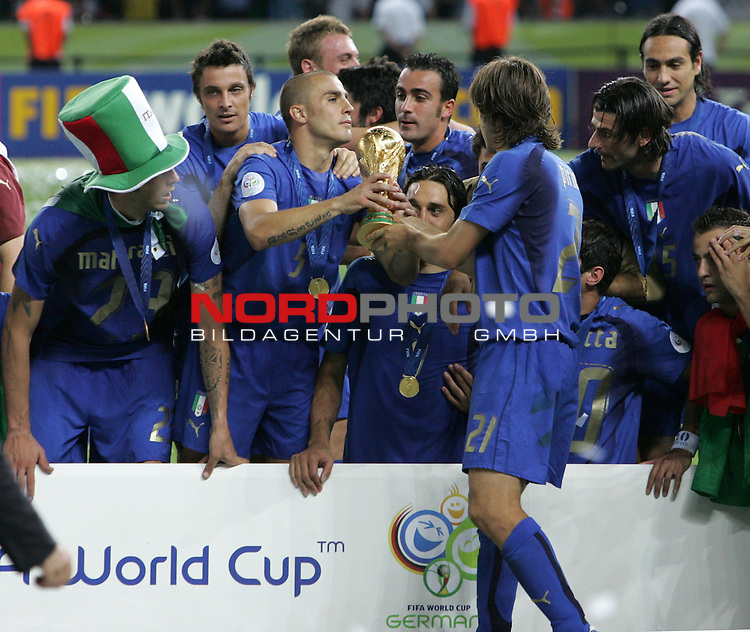 FIFA WM 2006 - Final / Finale<br /> Play #64 (09-Jul) - Italy vs France.<br /> Italy (Cristian Zaccardo, Fabio Cannavaro, Andrea Pirlo, l-r) is World Champion / Weltmeister 2006 mit dem Pokal / Trophy after the match of the World Cup in Berlin.<br /> Foto &copy; nordphoto