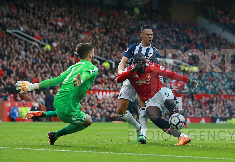 Ben Foster of West Bromwich Albion dashes out to save at the feet of Romelu Lukaku of Manchester United during the premier league match at the Old Trafford Stadium, Manchester. Picture date 15th April 2018. Picture credit should read: Simon Bellis/Sportimage