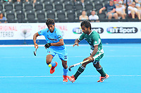 Pakistan's Ajaz Ahmad and India's Pardeep Mor compete for the ball during the Hockey World League Semi-Final match between Pakistan and India at the Olympic Park, London, England on 18 June 2017. Photo by Steve McCarthy.