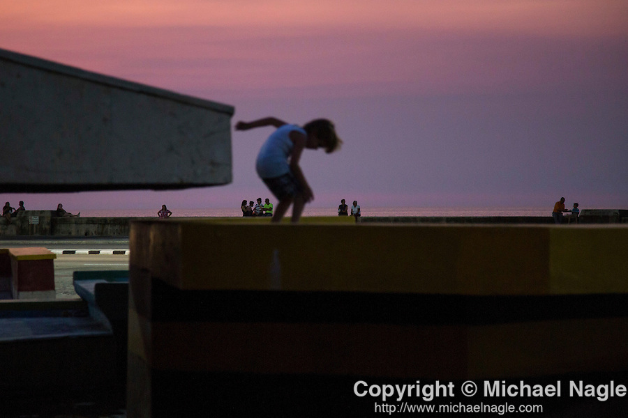HAVANA, CUBA -- MARCH 22, 2015:   Children play in a fountain along the Malecon in the Vedado neighborhood of Havana, Cuba on March 22, 2015. Photograph by Michael Nagle