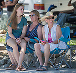 Rodeo fans watch the annual Reno Rodeo Cattle Drive come into Reno, Nevada on Thursday, June 14, 2018.