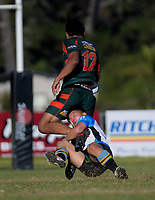 Pakuranga's William Rew is tackled during the Auckland Premier club rugby Alan McEvoy Trophy match between Pakuranga and Grammar TEC at Bell Park in Auckland, New Zealand on Saturday, 9 June 2018. Photo: Dave Lintott / lintottphoto.co.nz